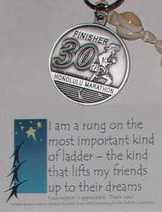 Vicky's Finisher medal with the magnet sent to supporters of the fundraising endeavor.