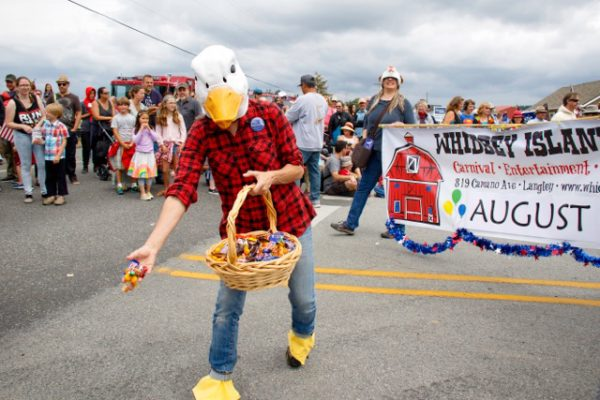Chickens and ducks and marchers tossed candy to children along the two-block parade route.