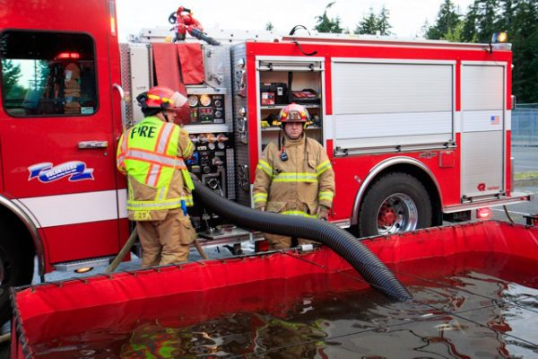 The pumper now has almost 3000 gallons to quench the flames.