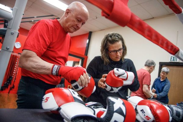 Coach Lauren Coleman helps to monitor progress, providing boxers encouragement and helping them develop correct technique.