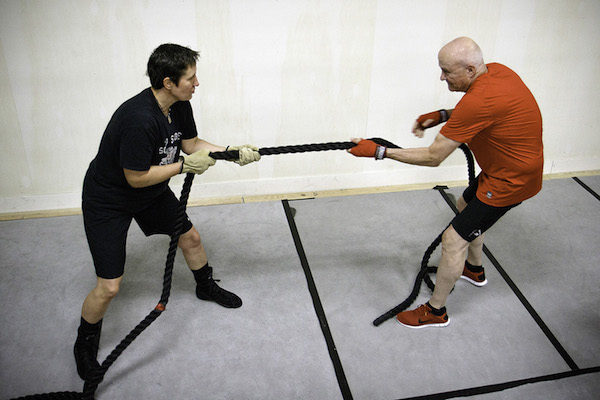 Medicine-ball exercises and rope-pull drills work on boxers' core strength and endurance.