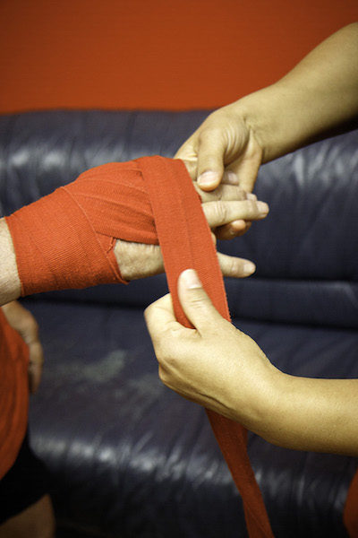 Hand-wraps protect the boxer's knuckles and wrists