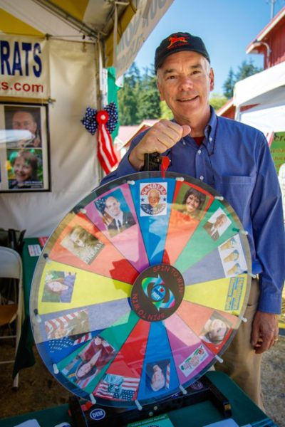 Duane Fulgham spins the political wheel of fortune at the Island County Democrat booth.