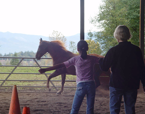 Girl with galloping Reba—in command, not control. So much more powerful. (photo courtesy of Peggy Gilmer)