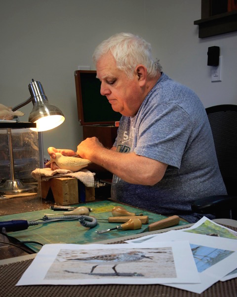 "Don Bundy researches his subject before he begins carving."" (photo by David Welton)"