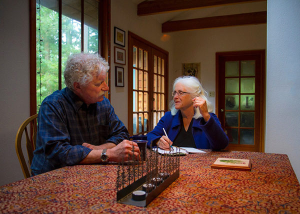 Mark Dworkin and Melissa Young at their dining room table.