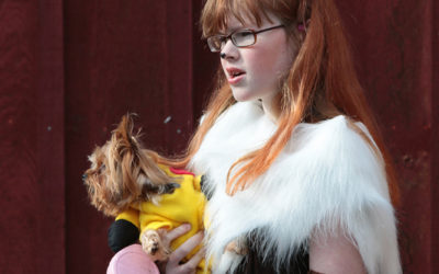 Teenaged girl and Yorkshire terrier in Pokémon costumes