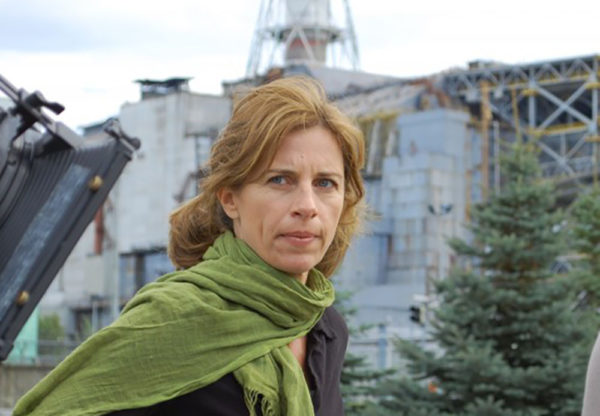 Filmmaker Holly Morris stands in front of the Chernobyl nuclear reactor (photo courtesy of Holly Morris)