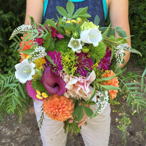 Kelly Uhlig composes a bridal bouquet. Photo by Pam Uhlig