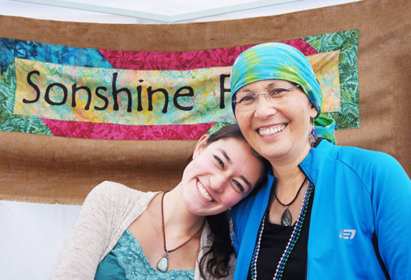 Kelly and Pam Uhlig of Sonshine Flower Farm at the Bayview Farmers' Market. Photo by Dianna MacLeod