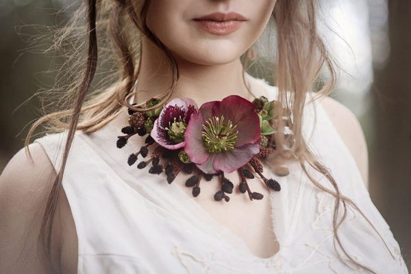 Hellebore and black pussy willow oral jewelry created by Vases Wild. Photo by Suzanne Rothmeyer