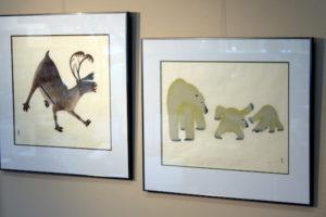 """""""Panniq,"""" and """"Playful Cubs,"""" both stonecuts by artist Kananginak. (photo by Don Wodjenski)"""