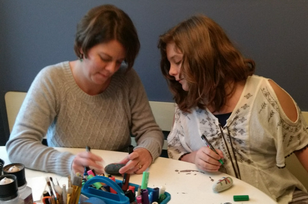 Shelly Darnell and her daughter Bailey painting rocks