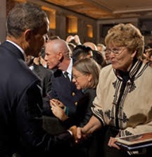President Obama shaking the hand of Margarethe Cammermeyer