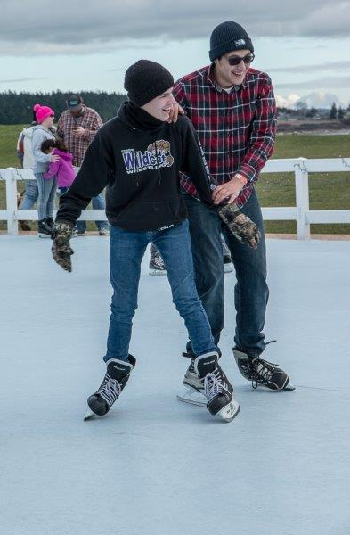 Two teen boys on skates
