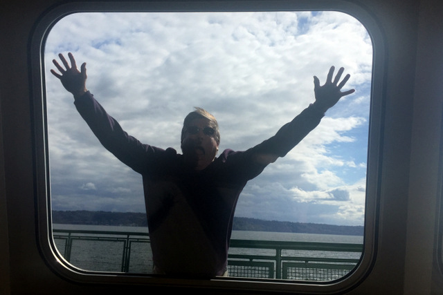 Man splayed against ferry window