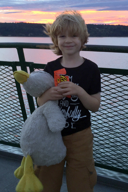Boy with plush duck toy